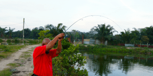 man using spinning rod