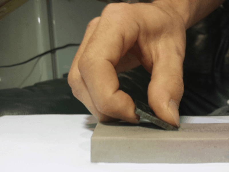 sharpening ice auger blade with stone